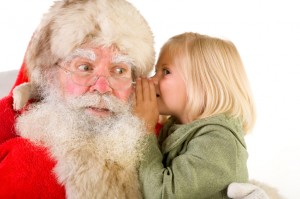 girl-whispering-into-santas-ear